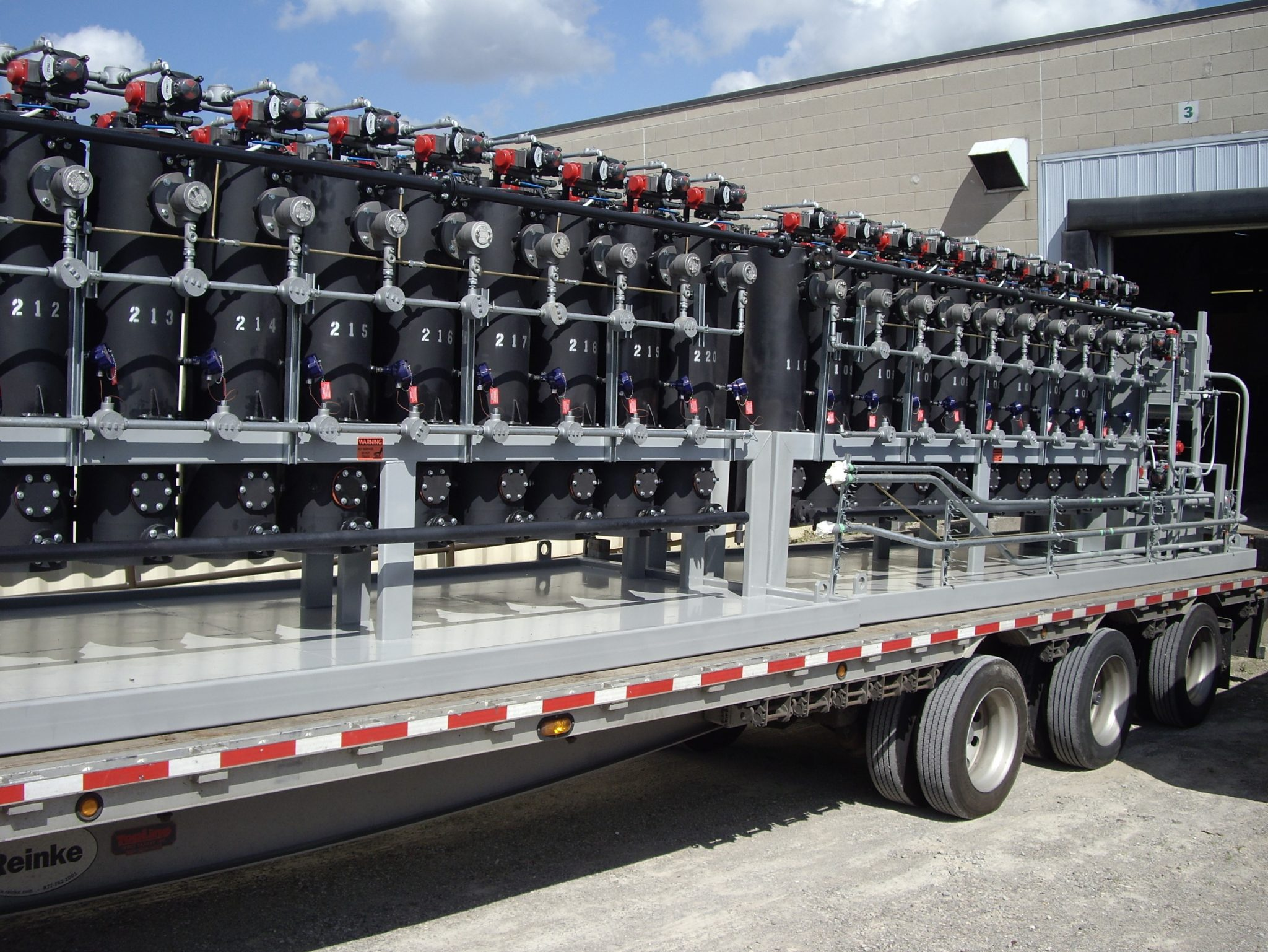 Stationary waste oil recycling system trailer